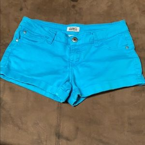 Bright blue stretchy jean shorts